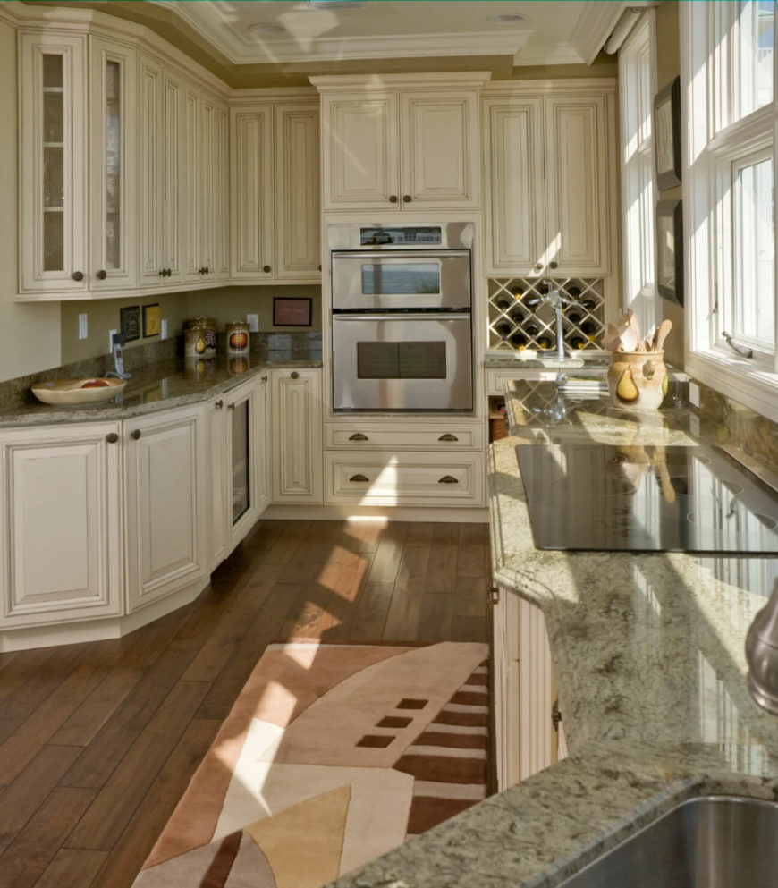 white kitchens with dark wood floors wood floors in kitchen This kitchen makes the most of its narrow presence with bold and detailed white cabinetry over
