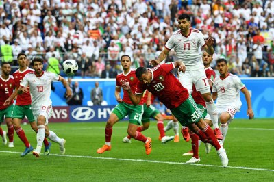 FIFA World Cup: Own goal crushes Morocco late, as Iran survives | ABS-CBN News