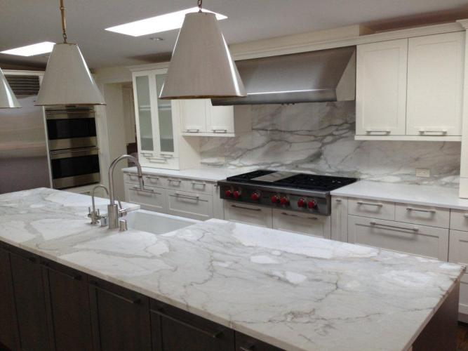 services marble kitchen countertops A remodeled kitchen with a slab of granite island matching backsplash