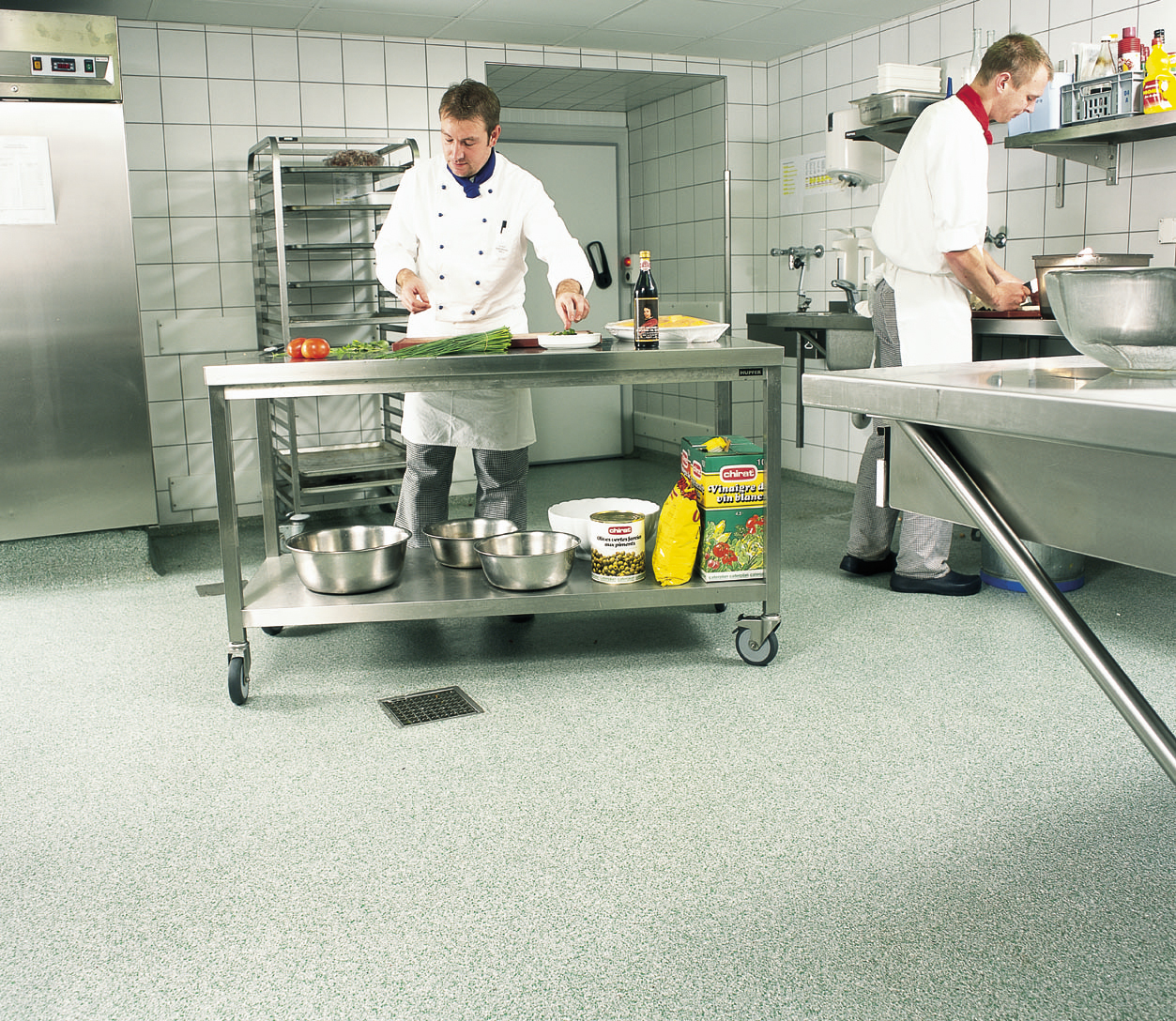 types of kitchen flooring commercial kitchen flooring Flake type of kitchen flooring with chefs cooking