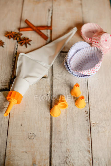 Cake decorating equipment on a wooden table     Stock Photo    194368456 Cake decorating equipment on a wooden table     Stock Photo