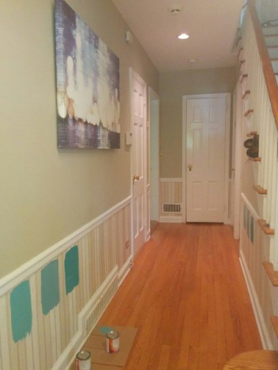Different paint shade below chair rail in foyer.