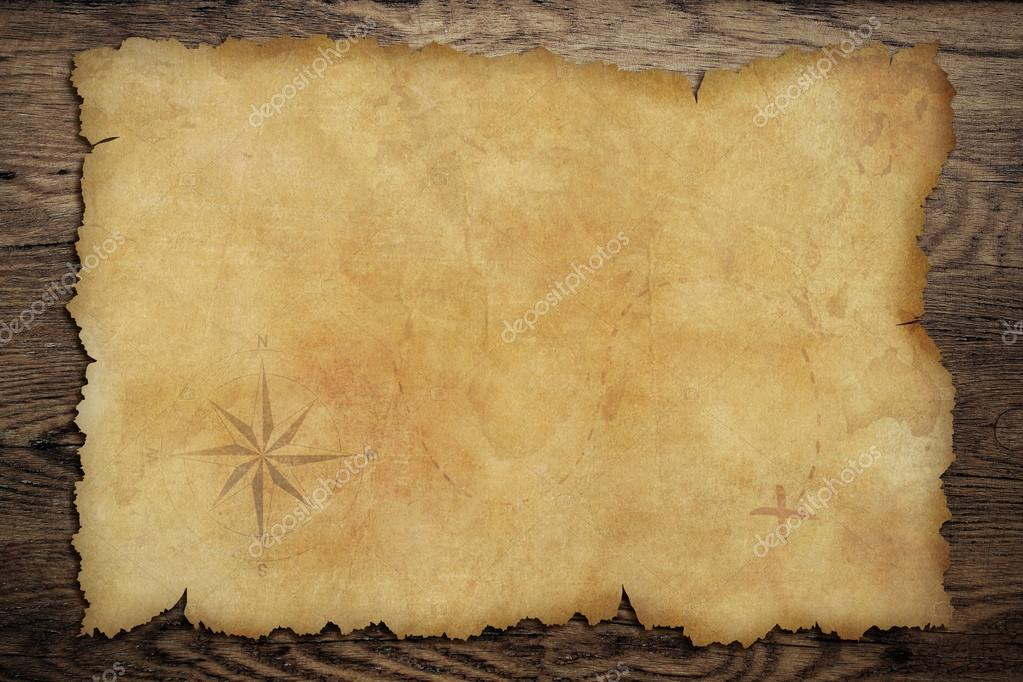 Pirates old parchment treasure map on wood table     Stock Photo     Pirates old parchment treasure map on wood table     Stock Photo