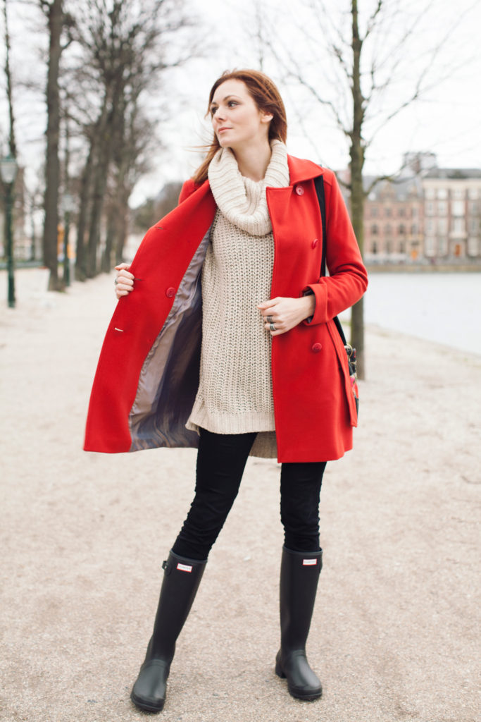 strolling the city in a red peacoat