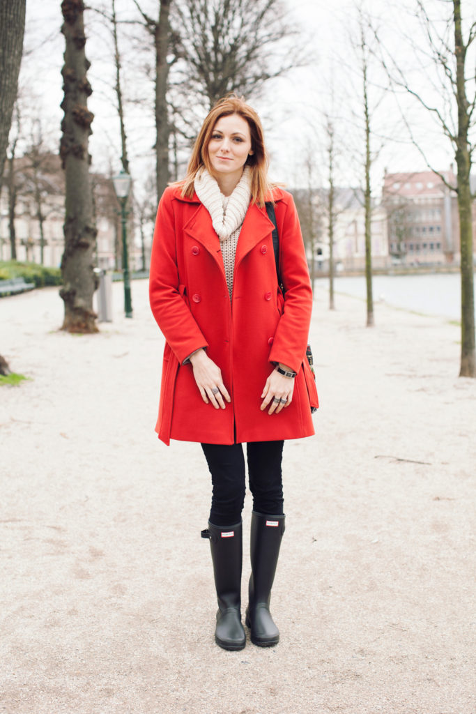 red coat and black hunter boots