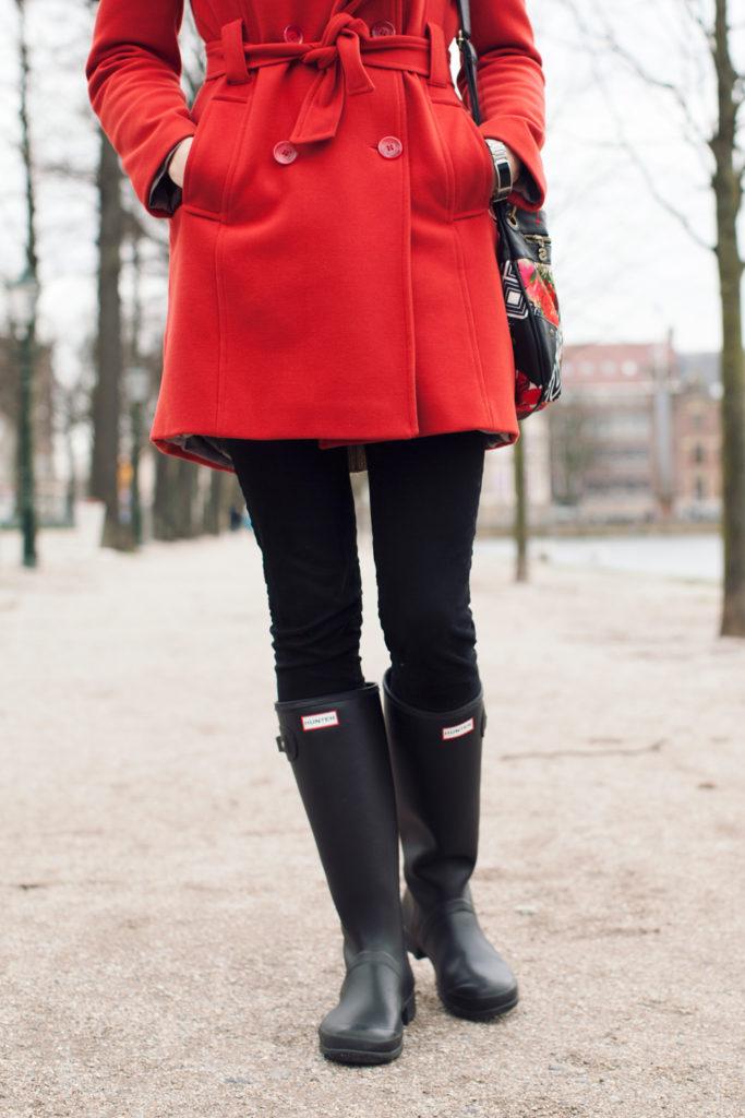 black pants and black hunter boots