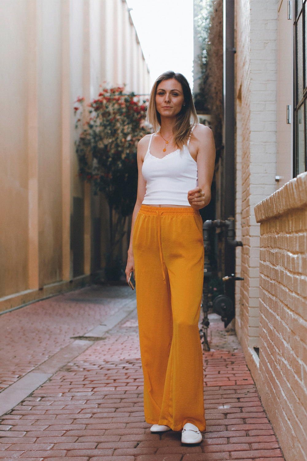 Satiny wide leg pants in mustard color