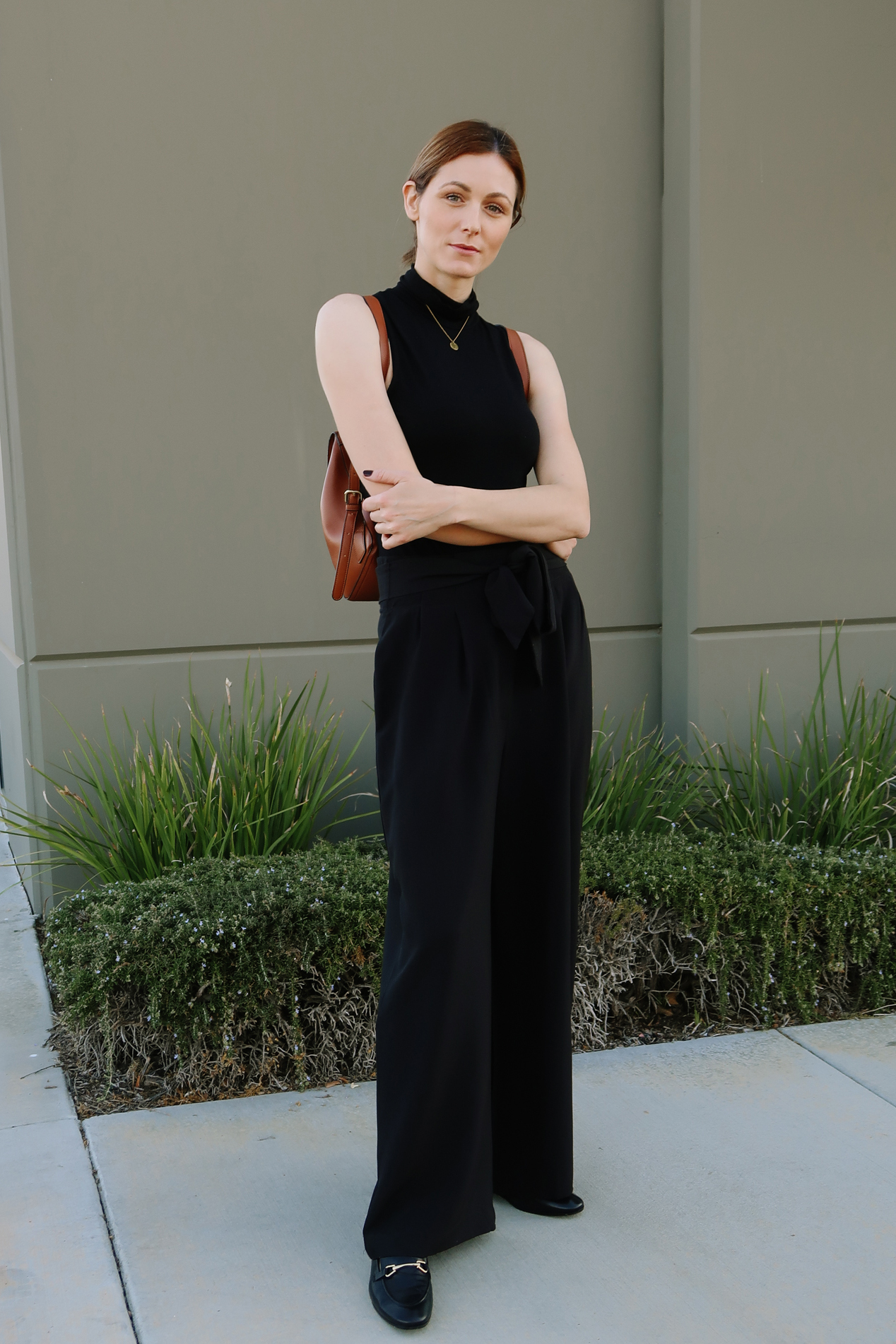 Wide-leg trousers casual outfit | Easy Casual Outfits To Try Right Now by popular California fashion blog, Tea Cups and Tulips: image of a woman outside wearing an Asos top, SheIn Paperbag Waist Slant Pocket Wide Leg Pants, and Amazon Happiness Boutique Circle Necklace.