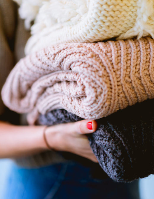 Cozy Fall Sweaters Under $100 by popular California fashion blog, Teacups and Tulips: image of a folded stack of sweaters.
