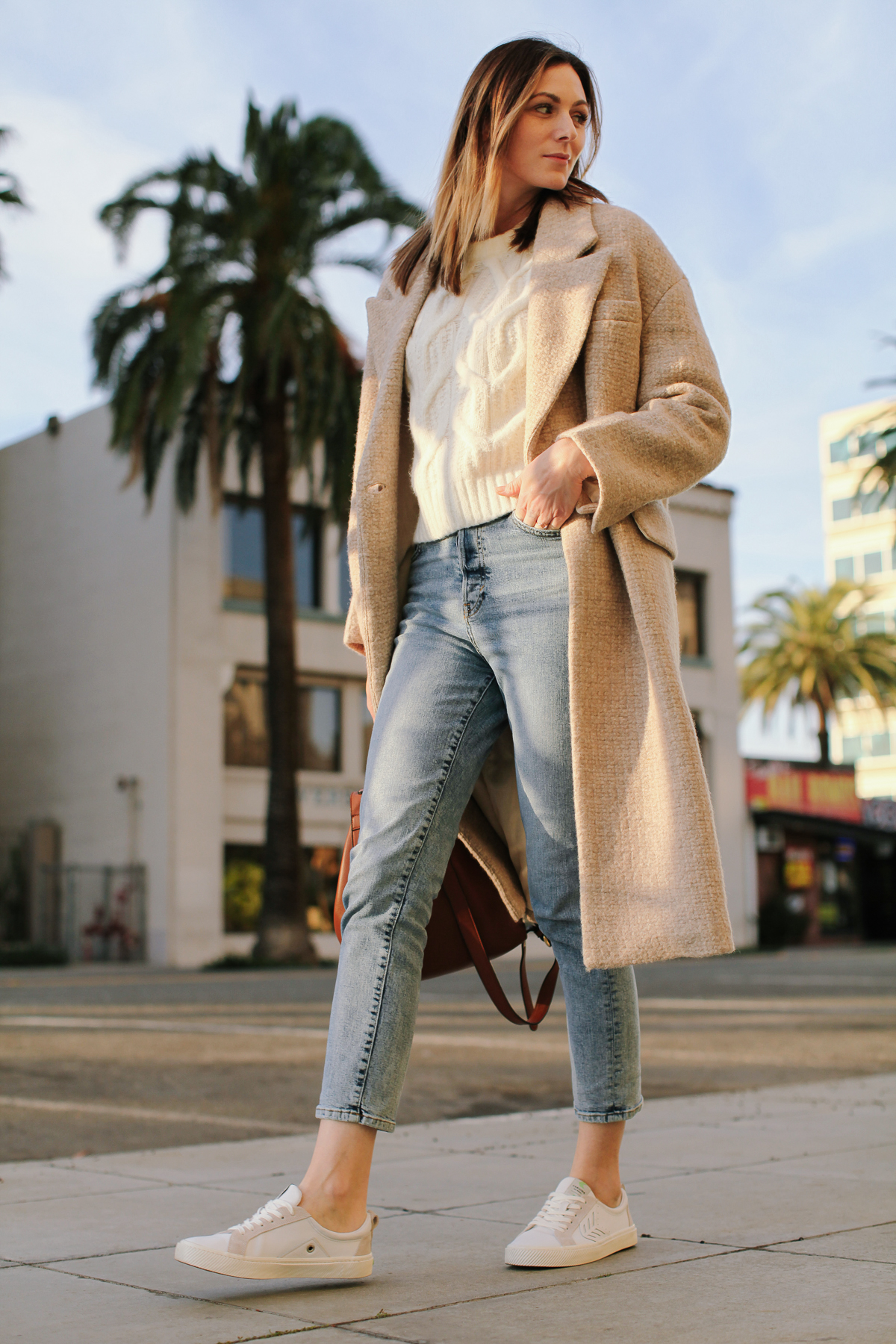 Cute Winter Coats for Women by popular LA fashion blog, Tea Cups and Tulips: image of a woman outside wearing a Zara wool winter coat, H&M Cable-knit Sweater, H&M Mom High Ankle Jeans, and Caiuma White /Ice Leather sneakers.