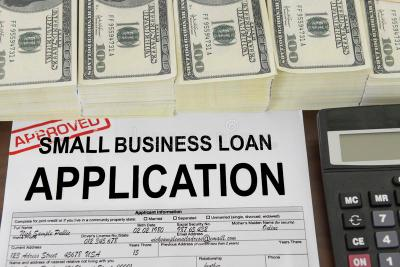 Approved Small Business Loan Application Form And Money Royalty Free Stock Images - Image: 28379959