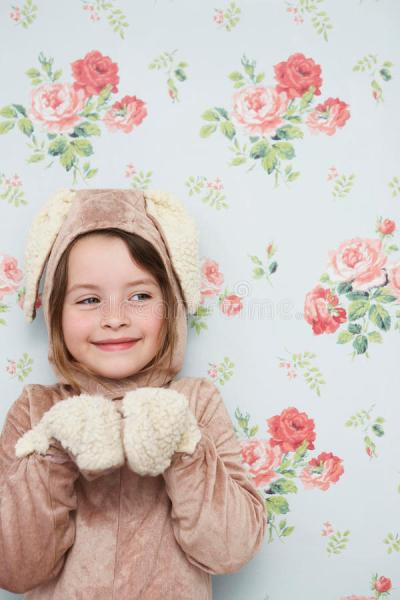 Cute Girl In Bunny Costume Against Wallpaper Stock Photo - Image: 33855614