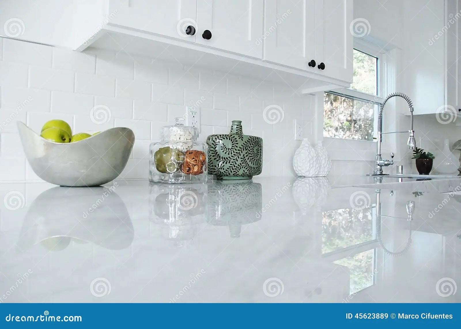 stock photo bright white kitchen carrara marble countertops chrome faucet image white kitchen countertops Kitchen Counter