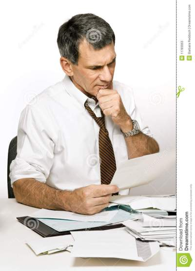 Confused Man Reading A Bill Or Bank Statement Stock Image - Image of frustrated, finances: 11783063