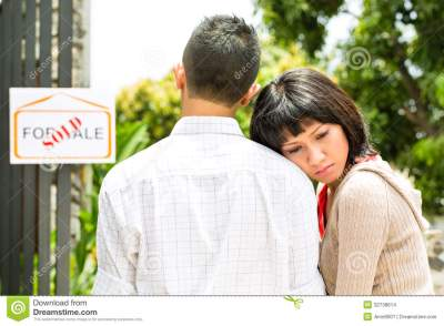 Disappointed Asian Couple In Front Of A House Stock Images - Image: 32738614