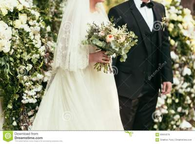 Groom In Black Suit And Bride In White Wedding Dress With ...