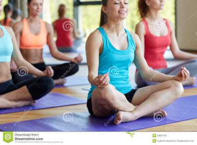 Group Of Happy Women Meditating On Mat In Gym Stock Image ...