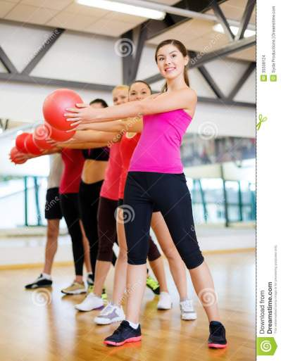 Group Of Smiling People Working Out With Ball Stock Images ...