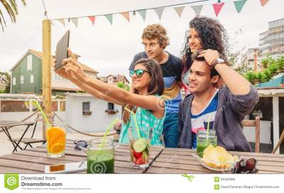 Group Of Young People Taking A Selfie With Tablet Stock ...