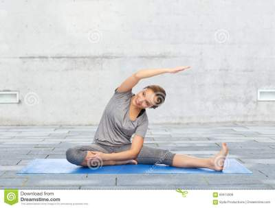 Happy Woman Making Yoga And Stretching On Mat Stock Photo ...