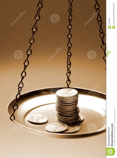 Money On A Balance Scale Stock Photo - Image: 1252180