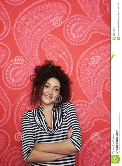 Portrait Of Teenage Girl Against Colorful Wallpaper Stock Images - Image: 31841524