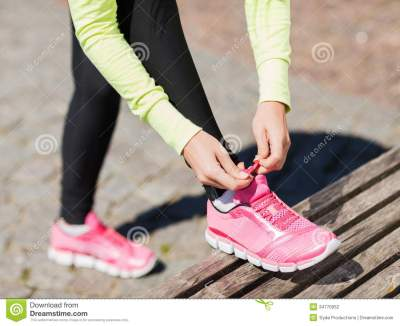 Runner Woman Lacing Trainers Shoes Stock Photo - Image of ...