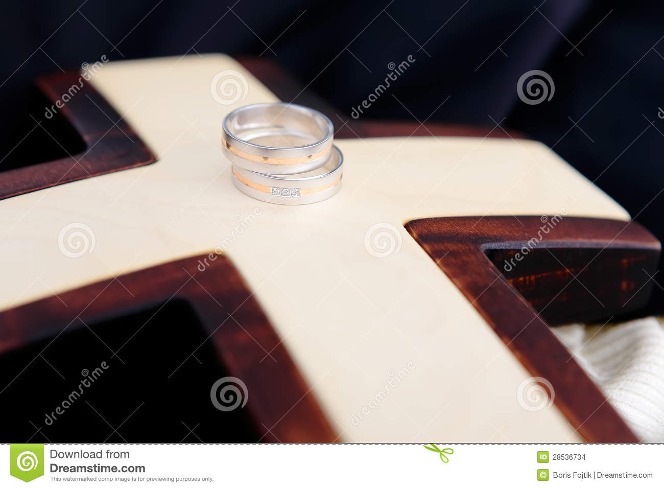 cross wedding rings cross wedding bands Wedding Rings and wooden cross Stock Images