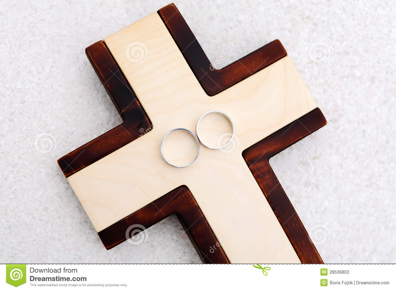 stock images wedding rings wooden cross image cross wedding bands Wedding Rings and wooden cross Stock Photos