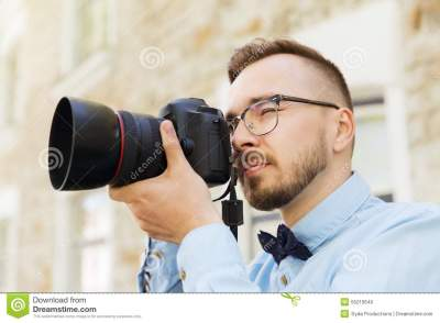 Young Hipster Man With Digital Camera In City Stock Photo ...