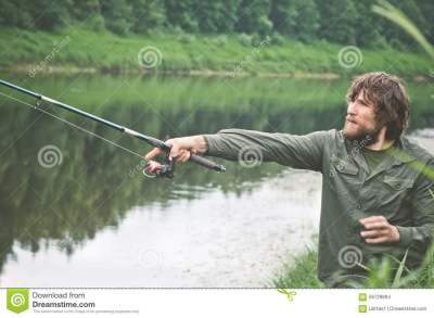 Young Man Fisherman Bearded Fishing With Rod Stock Photo ...