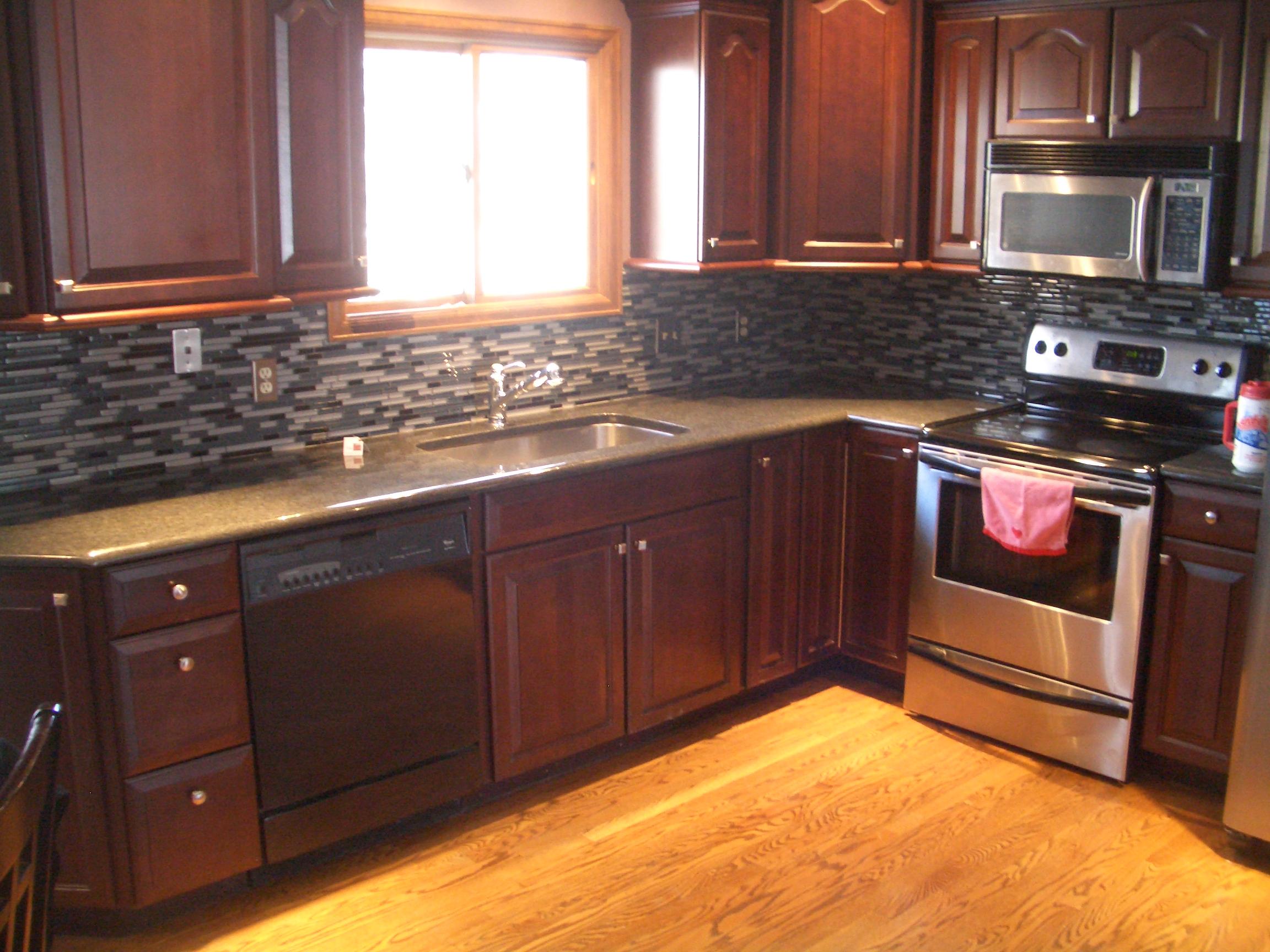 how to pick the perfect grout glass backsplash kitchen Dark glass kitchen tile backsplash in Fort Collins CO