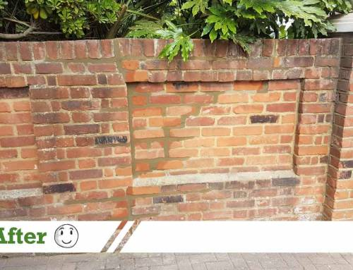 Brick wall repaired with stainless steel rods