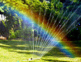 Rainbows  water and light   USGS Water Science School Homemade rainbow by using a yard sprinkler   Credit  Tim Perdue