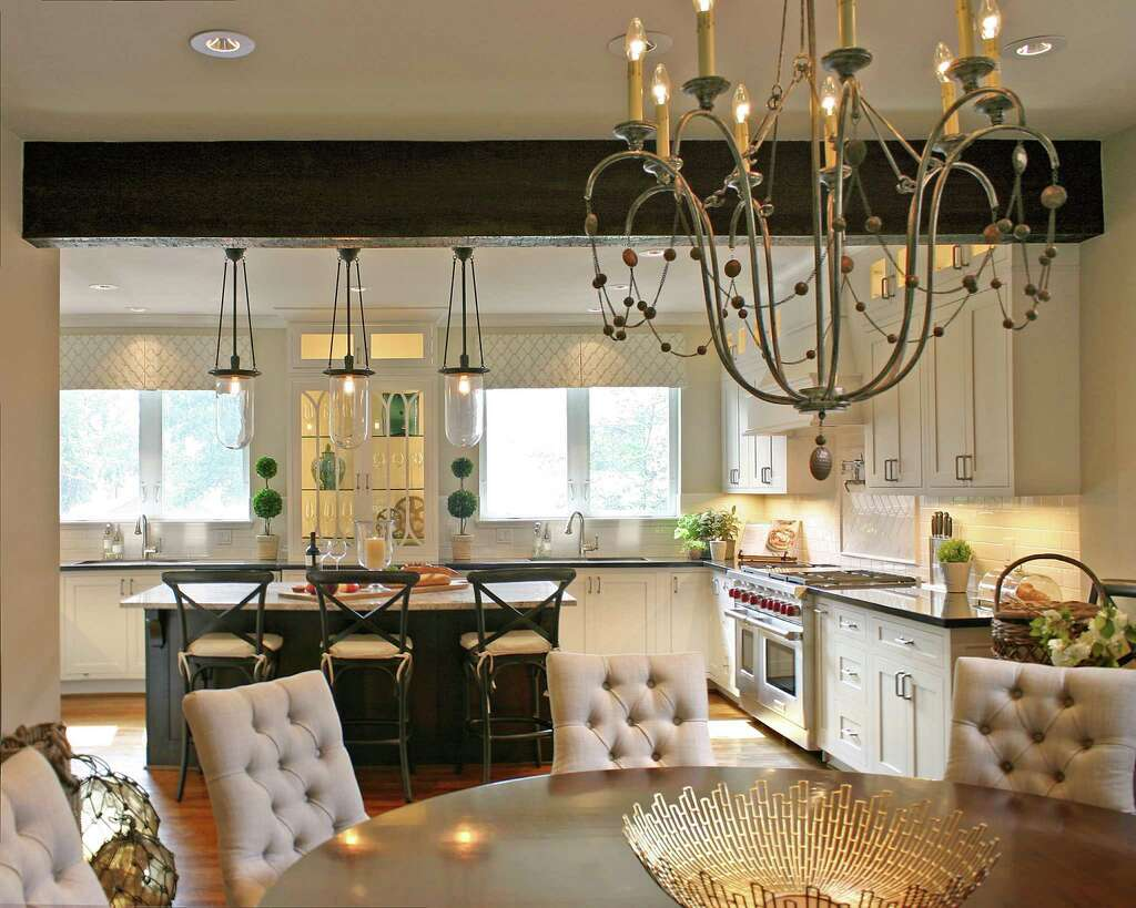 Before and after A total kitchen and dining murphy kitchen table Designer Ben Johnston hung the Devon chandelier by Arteriors Home above the dining table It