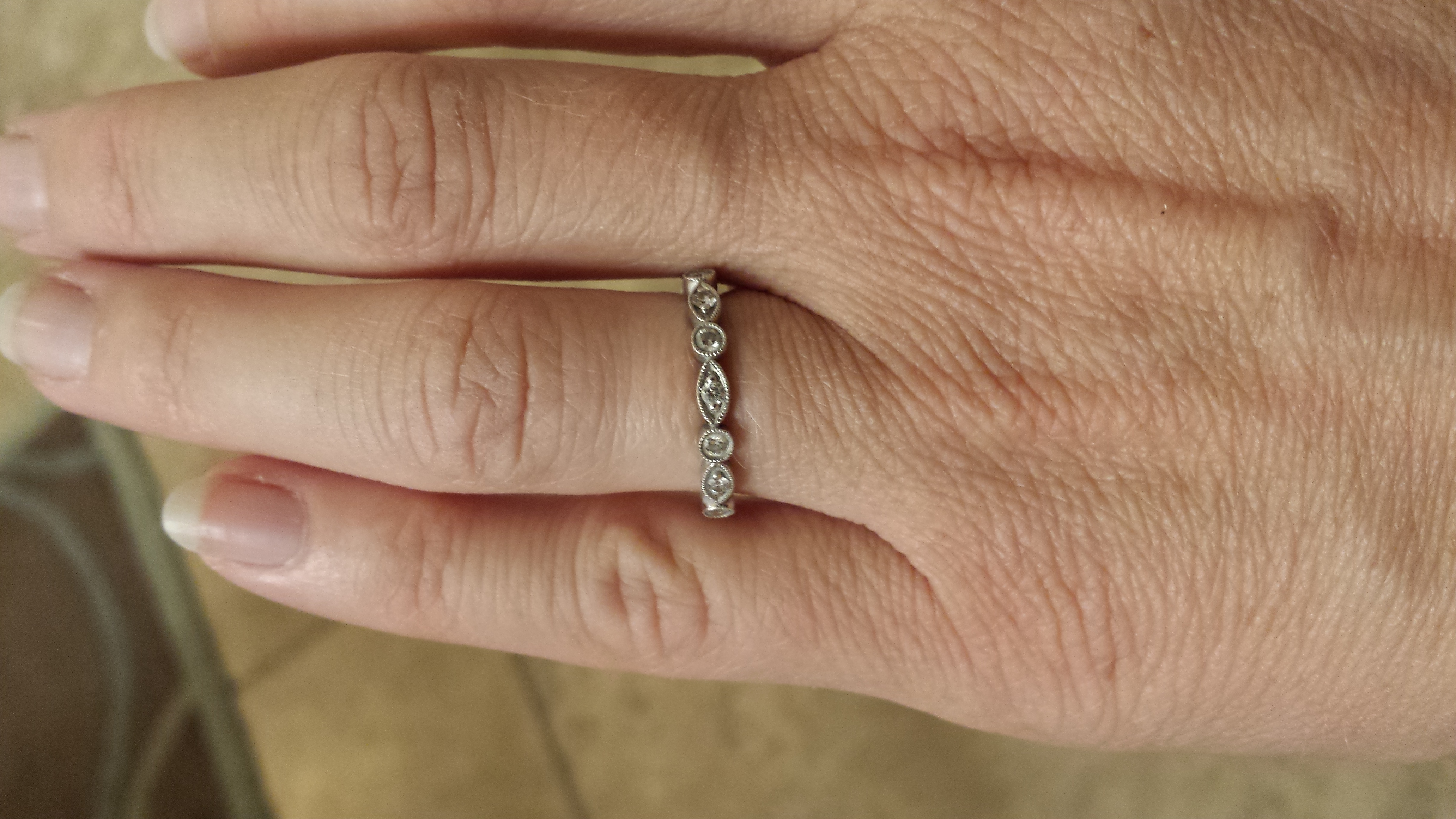 does anyone anywhere have this wedding band help please shane company wedding bands I purchased a very similar band from the Shane Co In February It is a half band of diamonds not an eternity band