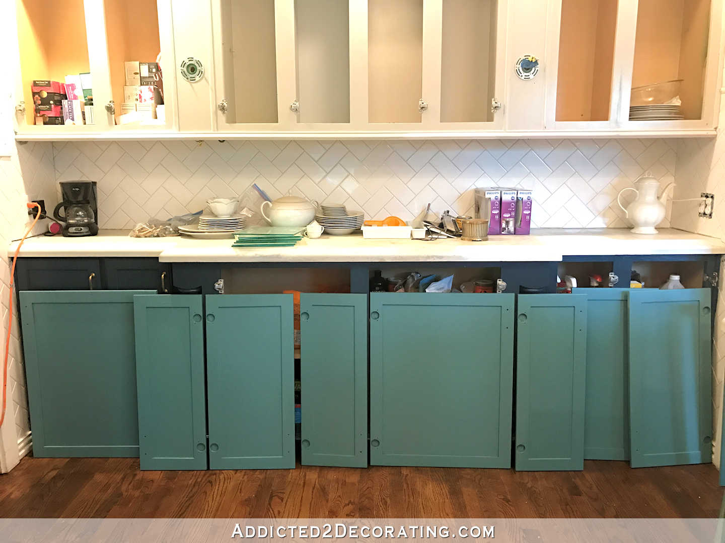 sneak peek teal paint color for kitchen cabinets backs of cabinet doors painted