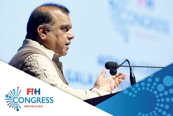 FIH President Dr Narinder Dhruv Batra addressing the guests at the FIH Honorary Awards ceremony in New Delhi. Credit: Hockey India