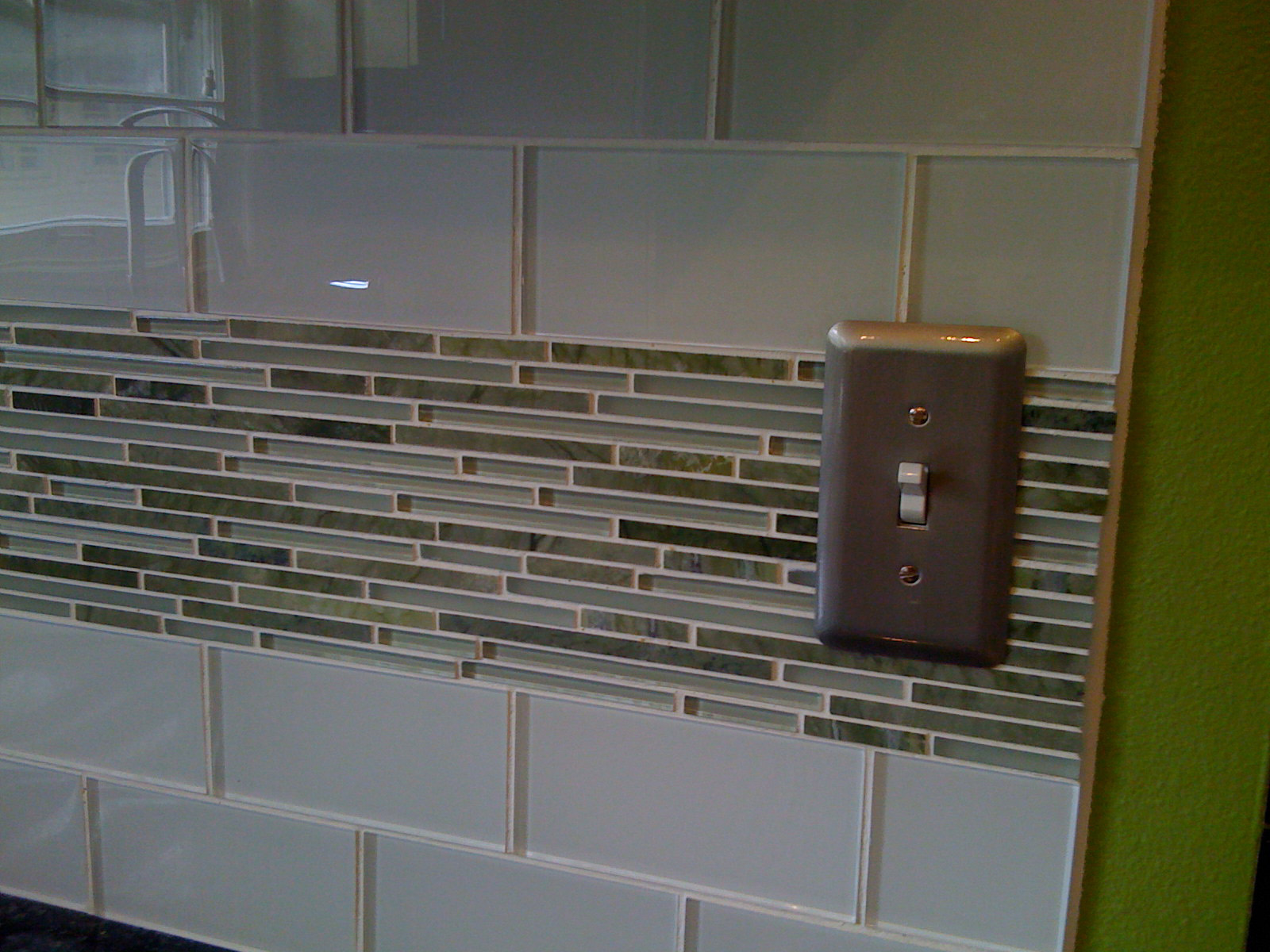 cat 1 glass tile backsplash kitchen This modern kitchen called for a detailed backsplash