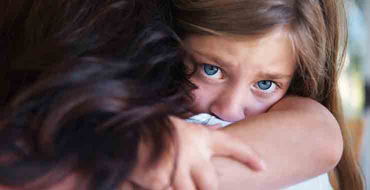 Helping your children manage distress in the aftermath of a shooting Sad frightened child