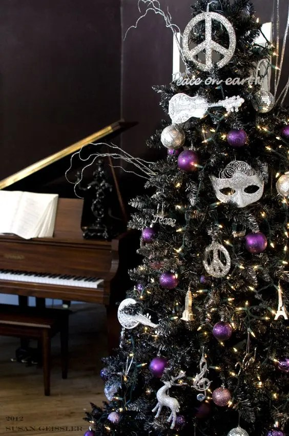 22 Unique Black Christmas Tree D    cor Ideas   DigsDigs a black tree with whimsy decor and silver and purple ornaments