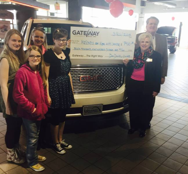 Friends of Kids with Cancer   Gateway Buick GMC sells cars to raise     Friends of Kids with Cancer accepting the check from Gateway Buick GMC  after sales in September 2014