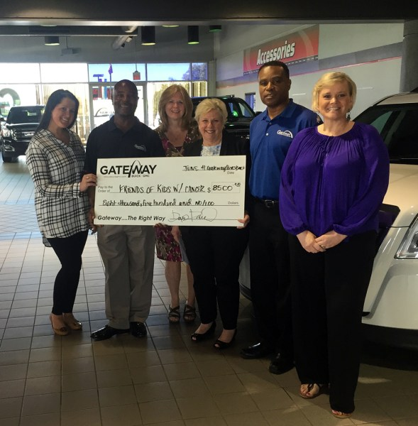Friends of Kids with Cancer   Gateway Buick GMC sells cars to raise     Friends of Kids with Cancer accepting the check from sales in June 2015