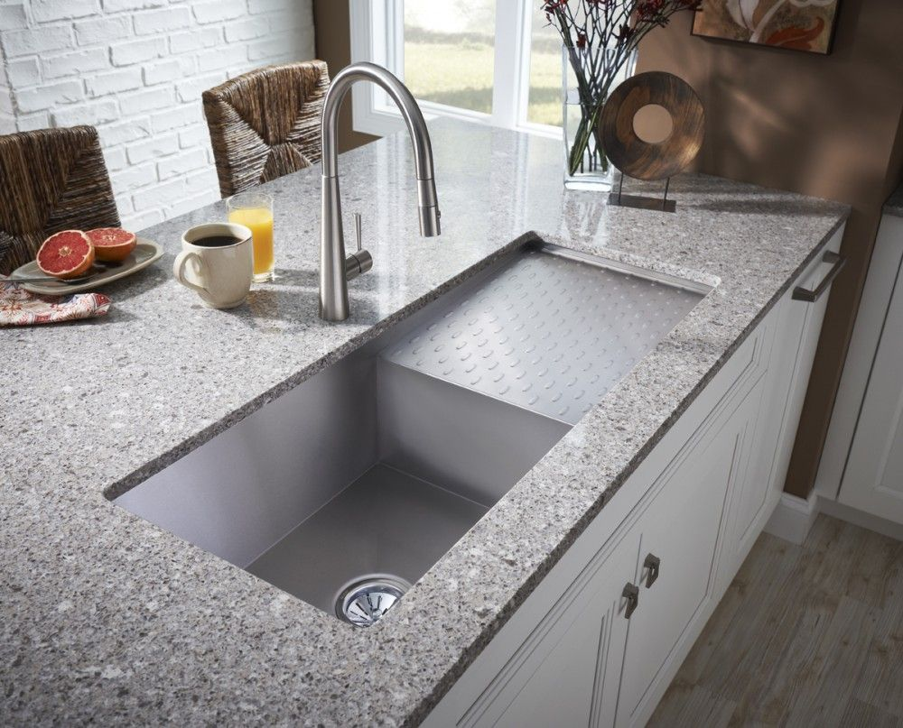 Minimalist Planted Kitchen Sink Deals with Stylish Faucet on Grey Granite Countertop beside Stools