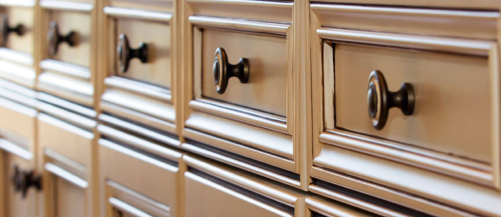 spotlight on cabinet knobs pulls and handles kitchen cabinet hardware Row of kitchen cabinet drawer fronts