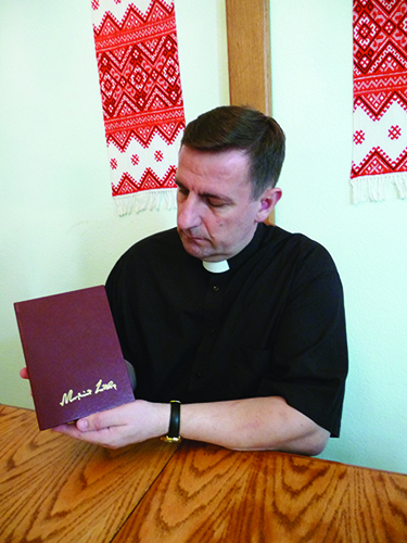 LHF in Ukraine   We wanted Luther to speak Ukrainian   Bishop Slavik Horpynchuk of the Ukrainian Lutheran Church holds a Ukrainian  translation of Luther s Works on the book of John