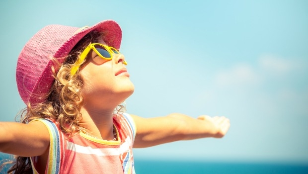 9 Ways to Stay Healthy and Happy This Summer   Live Happy Magazine Little girl in hat and sunglasses on the beach