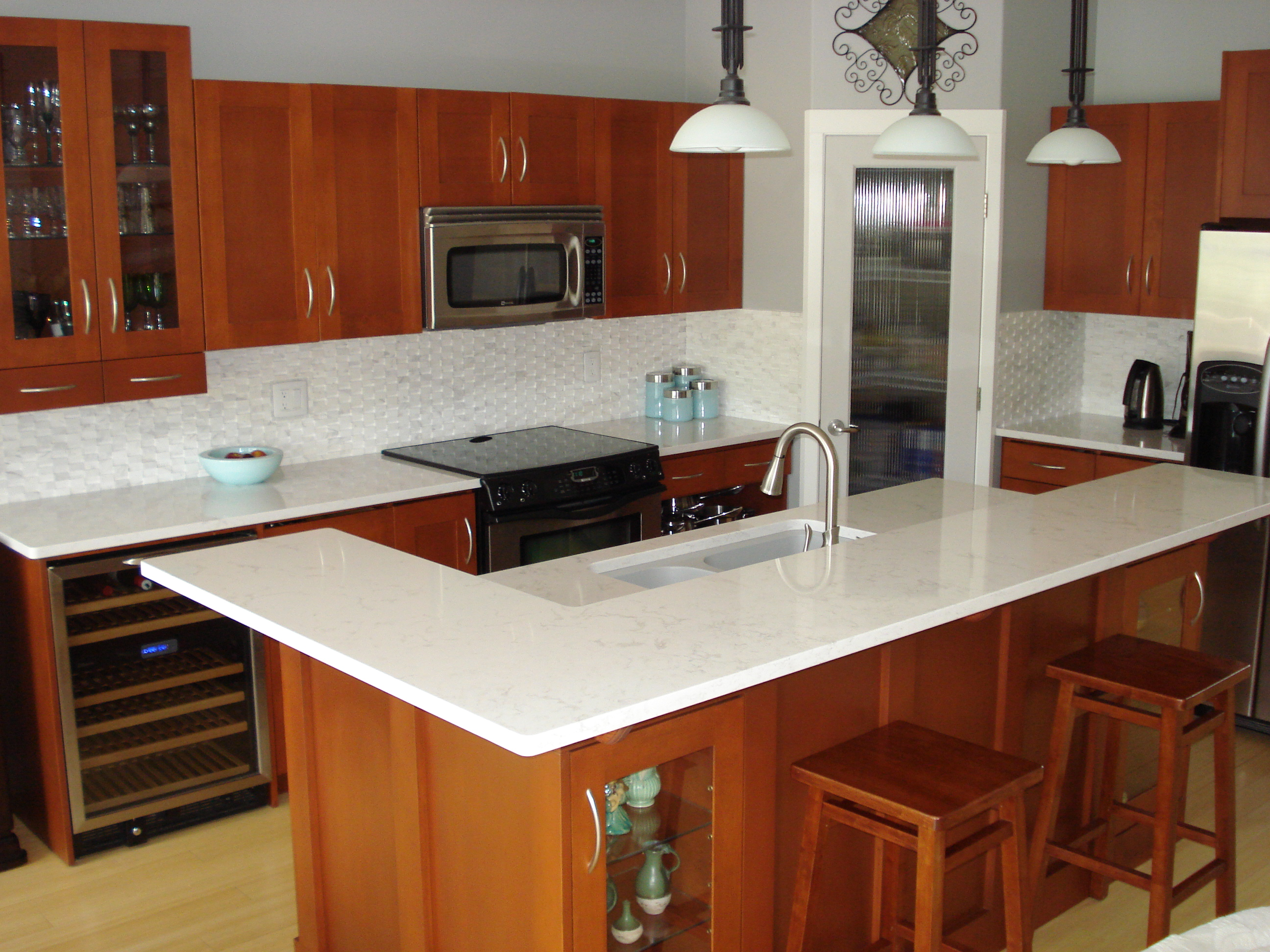 quartz countertops madeira stone penticton kelowna 2 quartz kitchen countertops Gorgeous White Quartz Countertops Make a Statement in this Okanagan Kitchen