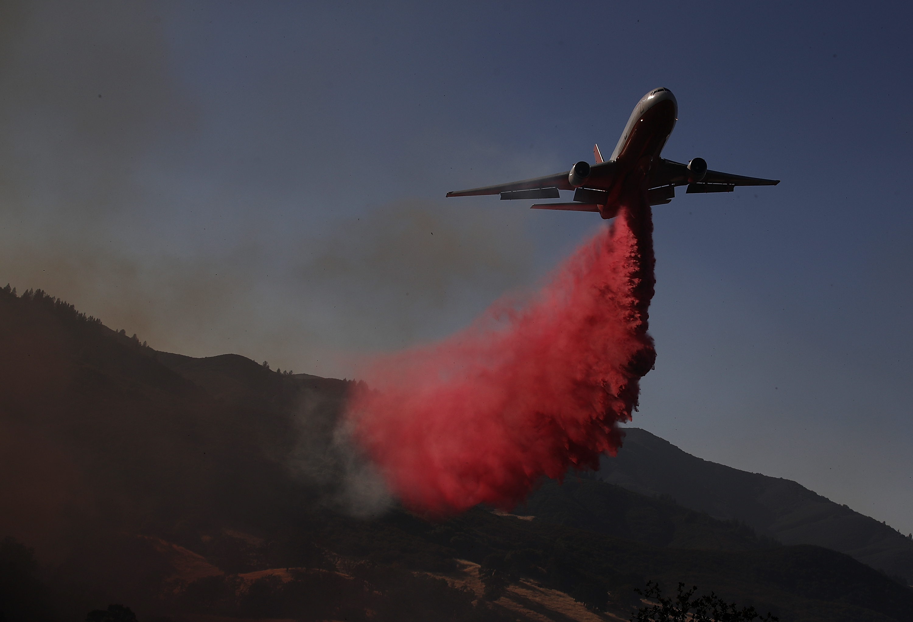 Mendocino Complex fire map  Now bigger than Carr Fire LAKEPORT  CA   AUGUST 01  A firefighting aircraft drops fire retardant  ahead of the River Fire as it burns through a canyon on August 1  2018 in  Lakeport