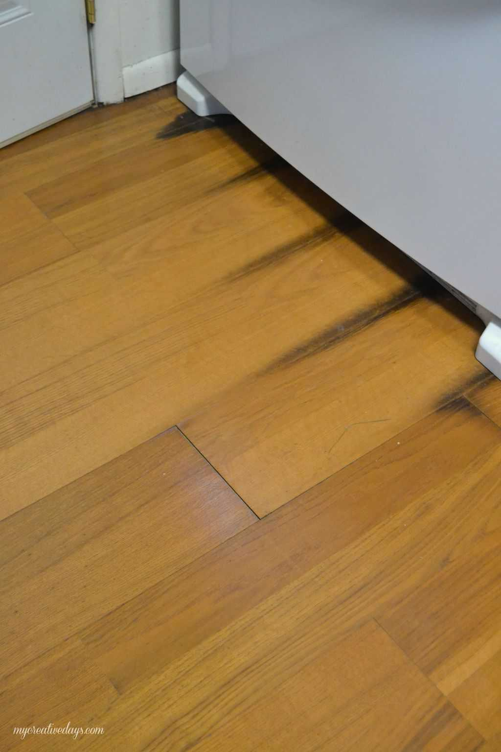 kitchen makeover laminate flooring flooring for kitchen Pin this Kitchen Makeover Laying Laminate Flooring mycreativedays com